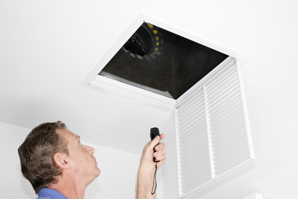 HVAC expert doing air quality inspection