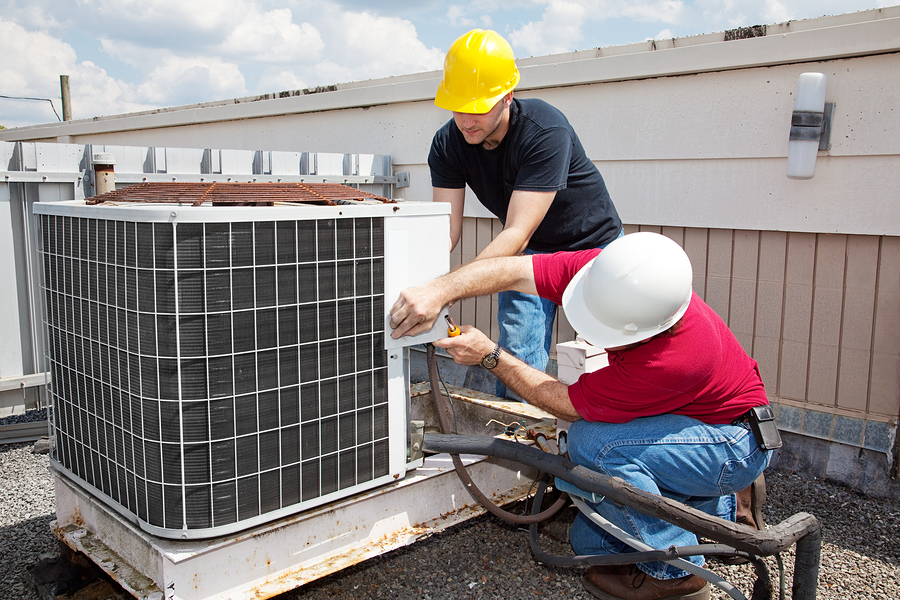 HVAC experts repairing HVAC unit