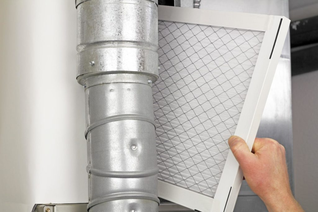 HVAC expert looking at duct and vent system