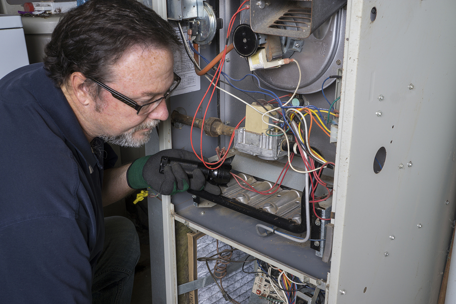 HVAC expert doing furnace services